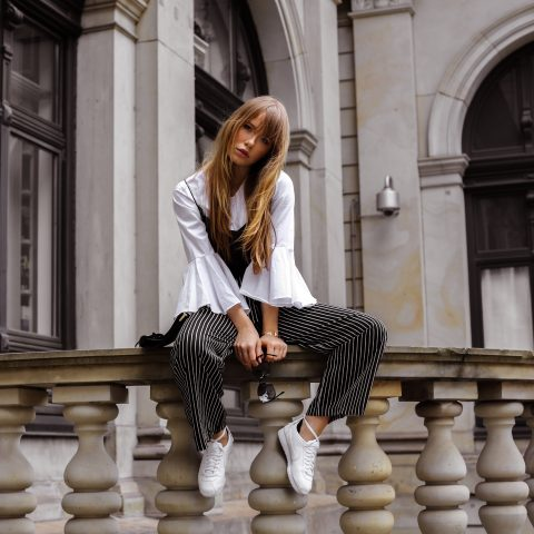 Wide sleeve blouse under top, Nike Cortez and striped trousers