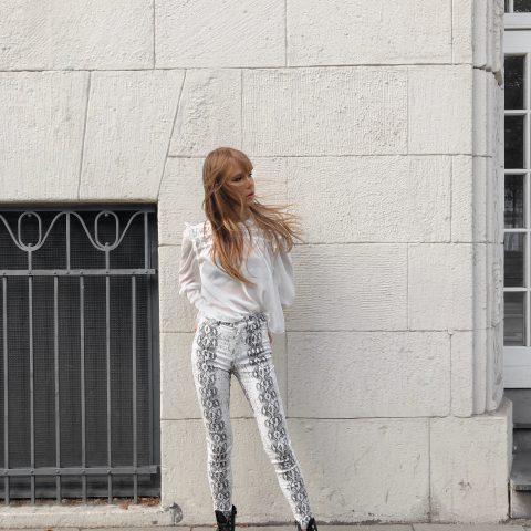 white ruffle blouse and snake pants