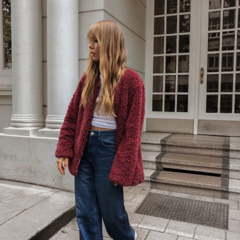 RED TEDDY JACKET AND FLARED JEANS
